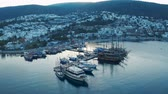 Aerial view of a small port with moored boats and yachts. Resort town Bodrum at the sunrise 4k