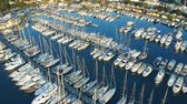 Aerial fly over boats and yachts moored in port. View from above 4k