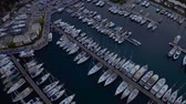 Fly over an elite yachts moored in the port eary in the morning. View from above 4k