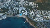 Aerial top view of the hotel with white houses and swimming pool. Bodrum, Turkey 4k Filmati Stock