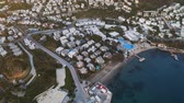 Fly over hotel resort with white houses and swimming pool. View from above 4k