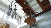 winch : Hooks hanging on factory beam crane at the plant. Work in the warehouse of metal, transportation of products 4k