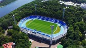eredivisie : Aerial view of Kiev Dynamo stadium in summer. Bank of the Dnieper River nearby 4k