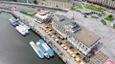 tram : Aerial view of river pier in Kiev. Postal Square in the capital of Ukraine. River trams and boats moored in the port. Tourist place in Podil 4k Stock Footage