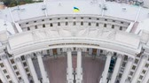 ukrán : Building of the Ministry of Foreign Affairs of Ukraine with a waving flag on top. Aerial footage. Tilting down shot 4k