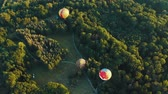 montgolfière : Aerial view of three hot air balloons takes off among the trees in the park. Beautiful sky and sunset 4k