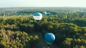 дирижабль : Hot air balloons takes off among the trees in the park during the festival. Aerial view from above 4k Стоковые видеозаписи