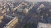 independence square : Aerial fly over Maidan Nezalezhnosti square in the fog and smog. Independence monument in Kiev Ukraine. Problem of pollution of the environment 4k