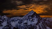 motion timelapse : Timelapse at the beautiful red sunset with the mountain covered in snow