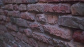 weathered : An outdoor brick wall