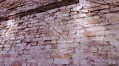 weathered : Old wall of brick blocks Stock Footage