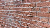bieg : Brick wall ruined and uncovered with concrete Wideo