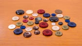 Sewing buttons of different colors in stop motion