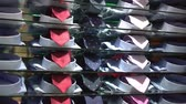 販売の : Shirts with ties for sale in the shop 動画素材