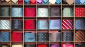 販売のための : Mens ties hanging on the shop wall that change their colors