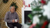 Рождественский подарок : Elder Man at the Christmas Party near the Fireplace