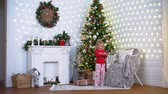 pajamas : Little Girl Making Selfie near the Christmas Tree