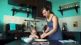 baking dishes : Mother and Daughter Sprinkle Cheese on the Pizza Base