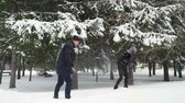 śnieżka : Man and Woman Playing Snowballs in Park