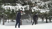śnieżka : Man and Woman Playing Snowballs