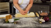 rolling pin : Senior Woman Rolling Dough on a Table