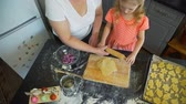 rolling pin : Little Girl with Grandmother Rolling Out a Dough