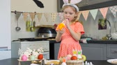 дегустация : Little Girl Tasting Cream for Easter Cookies