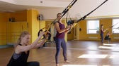 подвесной : Women Doing Exercise on trx at Fitness Club