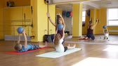пилатес : Children Doing Exercise with Medical Balls on Mats in a Gym under Physiotherapist Supervision. Rehabilitation Restoring after Injury Concept