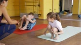 пилатес : Children Doing Exercises on Mats under Trainer Physiotherapist Supervision. Slow Motion. Rehabilitation after Trauma Concept