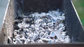 уголь : Glowing Coals with Smoke and Flying Small Pieces of Ash in the Brazier after Preparing Meat on Charcoal Grill. Leisure, Food, Family and Holidays Concept
