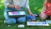 ressam : Little Girl and Teacher Drawing Together with Watercolor Outdoors. Painting Art Classes. Drawings Creation. Development of Childrens Artistic Creativity and Thinking