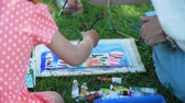 obrazy : Children with Teacher at Painting Lesson in Nature. Watercolor Painting Lessons and Art Classes Outdoors. Slow Motion. Development of Childrens Artistic Creativity and Thinking