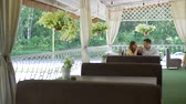 razem : Young Couple Enjoying Spending Time Together on the Summer Terrace. Man and Woman Drinking Tea and Chatting in a Cafe. Lifestyle and Romantic Relationship Concept