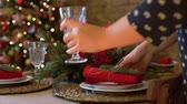 サービング : Close Up of Woman Preparing Dinner Table for Christmas Celebration. Winter Holiday Celebration and People Concept