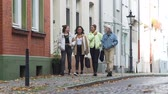 ırklı : Four Mixed Race Teen Girlfriends Walking Near Bicycle Lane in the Centre of an Old German City in Autumn Day. People, Leisure, Friendship and Communication concept