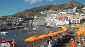 napoles : Picturesque Beach of Sant Angelo on Ischia Island, Italy. Amazing Place with Colored Houses Joined to the Hill in the Tyrrhenian Sea. Concept of Holidays, Vacations and World Travel Concept Archivo de Video