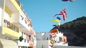 ulusal bayrağı : Colorful Flags of Different Countries Hanging on a Rope in Beautiful Town of Southern Italy. Slow Motion. Concept of Holidays, Vacations and World Travel Concept