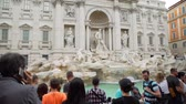 italyan kültürü : Rome, Italy - October 5, 2019: Tourists Taking Photos and Enjoying View of Fontana di Trevi (Trevi Fountain) in Rome, Italy. Concept of Holidays, Vacations and Travel in Europe