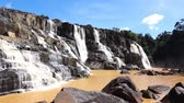 latão : Moving footage 4k Pongour waterfall in Dalat Vietnam. Scenic mountain with fall