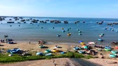 vessel traffic : 4k footage pan image Fishing village with fishing boat and traditon boat , Mui Ne, Vietnam, Southeast Asia Stock Footage