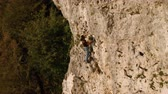góral : A rock climber climbs a category 5 route along a rock