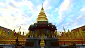 lanna : Time lapse video of Phra That Hariphunchai with clouds flowing, Thailand.