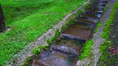 krok : 4K video of water flowing in the step gutter, Thailand. Wideo
