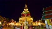 lanna : 4K time lapse video of Phra That Hariphunchai temple in the night, Thailand.