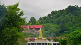 lanna : 4K time lapse video of Pong Yaeng Chaloem Phrakiat temple with mountain view, Thailand.