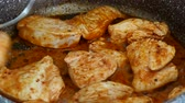 pieces of chicken cooked in pan, fried chicken breast in pan, close-up.