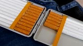 cigarette : jeans and tobacco (cigarette) on it