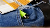 jeans and cigarette layer on it, jeans and tobacco (cigarette) on it, 動画素材
