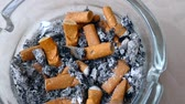 cigarette butts in ashtray, close up,